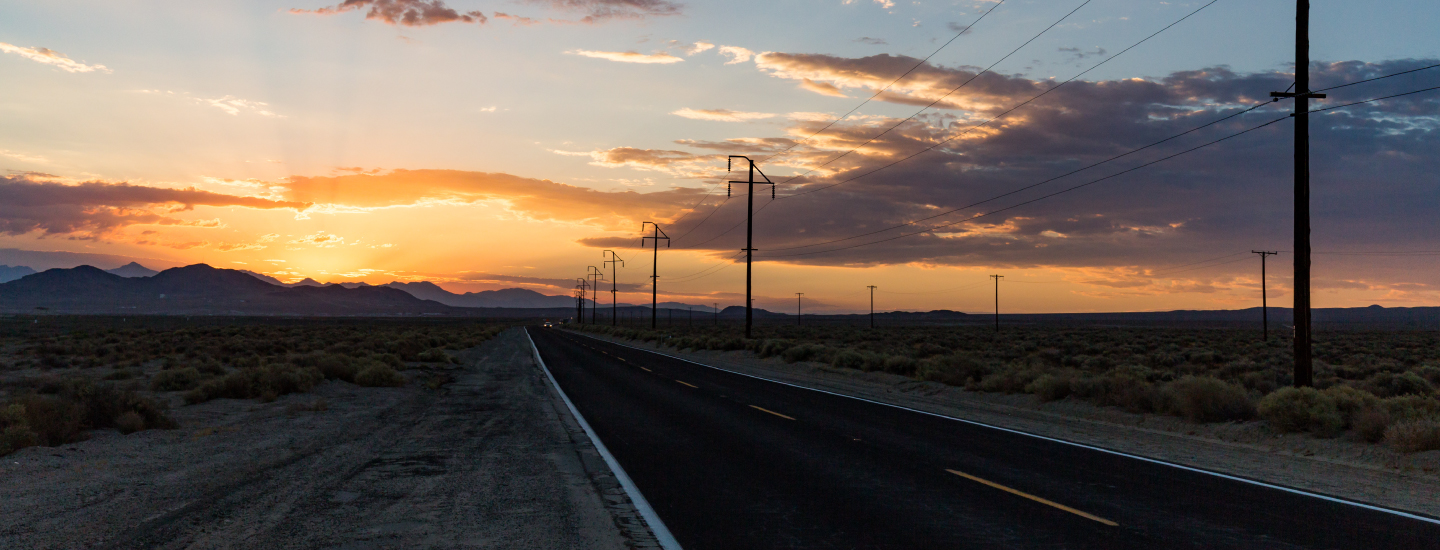 Power Lines and Sunset on Rural Nevada Highway